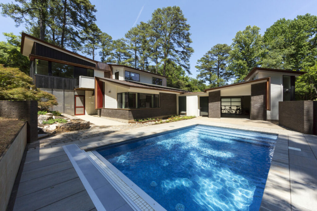 a home design with a pool by Oxide Architecture