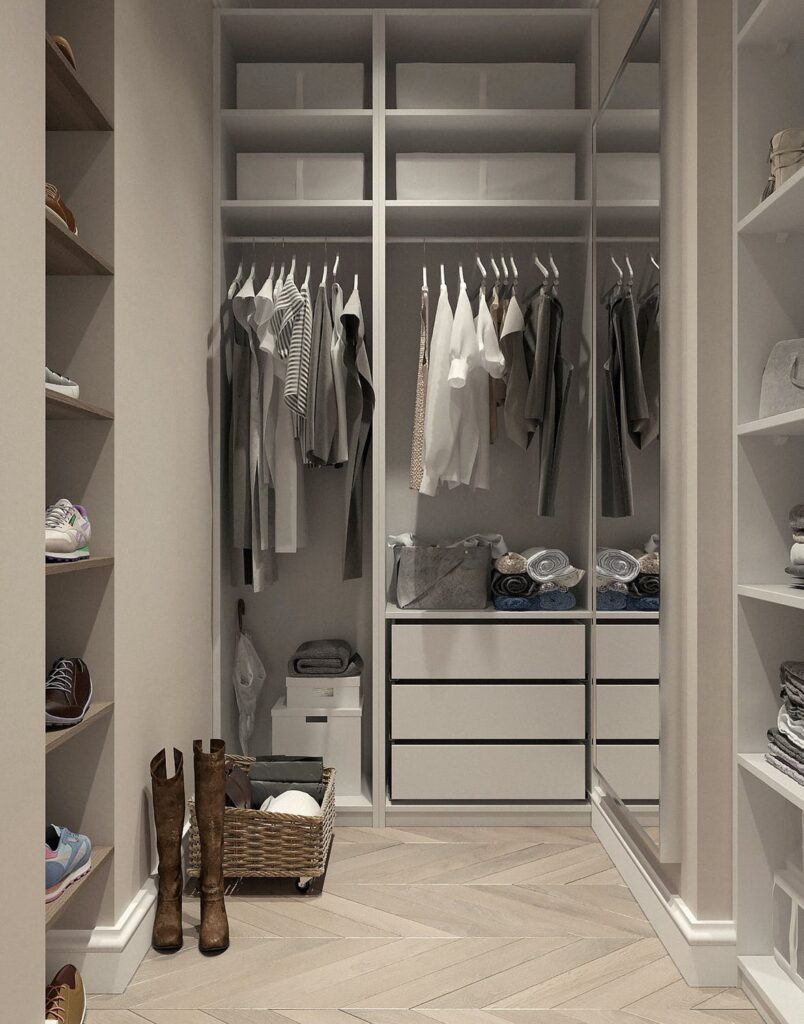 A walk in closet with clothes in it